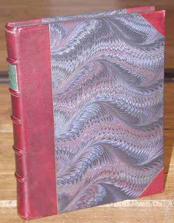 Three-quarter leather binding with marbled paper covers.