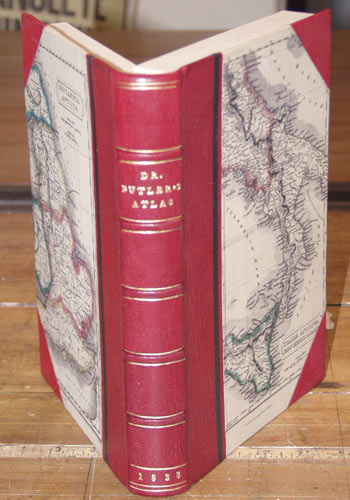 Three-quarter leather binding, with leather spine and corners.